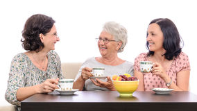Family talking at coffee Stock Images
