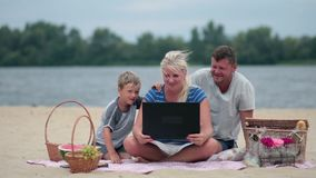 Family talking with grandparents using laptop Stock Photography