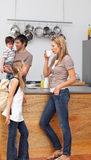 Family talking in the kitchen before school Stock Photography