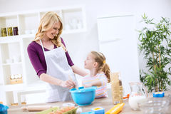 Family teamwork cooking Royalty Free Stock Images