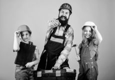 Family teamwork. Repair. Bearded man with little girls. construction worker assistant. Builder or carpenter. Repairman royalty free stock image