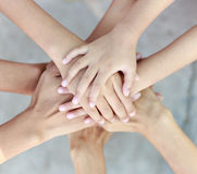 Family teamwork stack of hands stock images
