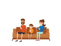 Family technology concept. Family sitting on sofa in living room Royalty Free Stock Photo