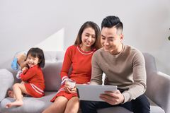 Family, technology, parenthood and people concept - happy mother stock photography