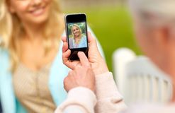 Senior mother photographing daughter by smartphone Royalty Free Stock Photography
