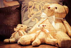 Family of teddy bear. Three teddy bears sit having embraced royalty free stock images