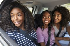 Family With Teenage Children In Car On Road Trip royalty free stock photos