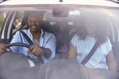 Family With Teenage Children In Car On Road Trip royalty free stock image