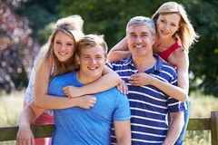 Family With Teenage Children Walking In Countryside Royalty Free Stock Photos