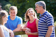 Family With Teenage Children Walking In Countryside stock photo