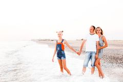 A family with a teenage girl is resting on the sea. stock image
