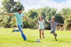 Family with teenager playing in soccer Stock Images