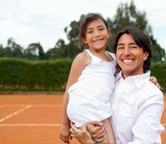 Family at a tennis court Royalty Free Stock Image