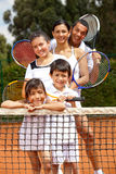 Family at the tennis court Stock Photo