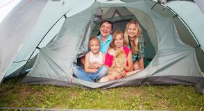 Family in a tent at summer stock image