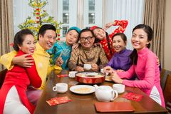 Family at the Tet table stock image