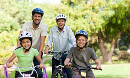 Family with their bikes Royalty Free Stock Photography