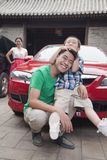 Family with Their Car Stock Images