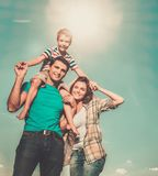 Family with their child outdoors Stock Photography