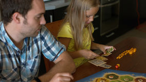 Family with their little daughter playing the board game Stock Photo