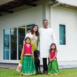 Family with their new house. Stock Photo