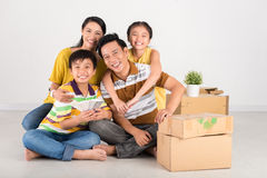 Family in their new house Royalty Free Stock Photography