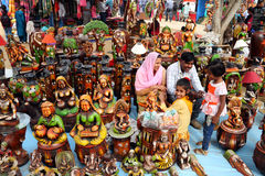 Family at their shop in Surajkund Crafts Mela Stock Photo