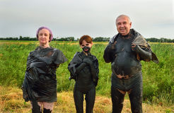 Family in therapeutic mud Royalty Free Stock Image
