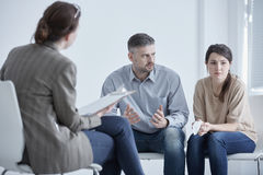 Family therapist and unhappy couple. Family therapist during meeting with unhappy, married couple Royalty Free Stock Images