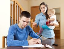 Family of three with baby having quarrel Royalty Free Stock Image