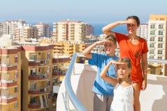 Family of three on the balcony at the hotel Stock Photo
