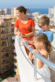 Family of three on the balcony of the room Royalty Free Stock Photography