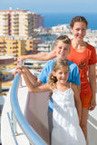 Family of three on the balcony Royalty Free Stock Images