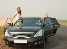 Family of three  by car Royalty Free Stock Image