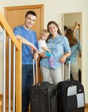 Family of three with child together with luggage Stock Photo