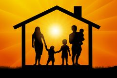 Family with three children in the house at sunset. Royalty Free Stock Image