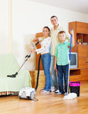 Family of three with  cleaning equipment Stock Photo