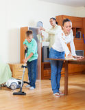 Family of three  cleaning in home Royalty Free Stock Image