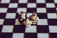 Family of three close up mom dad child metaphor toys Royalty Free Stock Photography