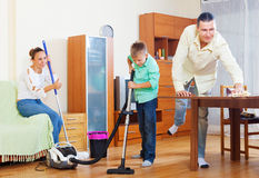 Family of three  doing housework together Royalty Free Stock Photo