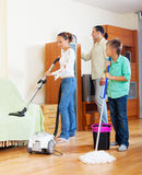 Family of three  doing housework together Stock Images