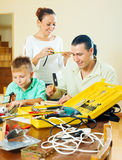 Family of three doing something with the working tools Stock Image