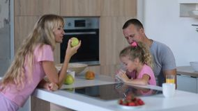 Family of three enjoying breakfast together stock footage