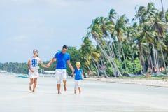Family of three having fun at the beach Royalty Free Stock Image