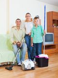 Family of three finished cleaning Stock Photo