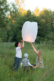 Family of three flying paper lantern outdoor Stock Images