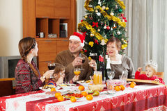Family of three generations  around festive table Stock Images