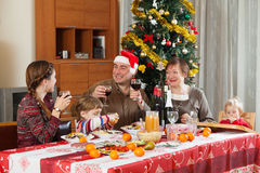 Family of three generations  around festive table Royalty Free Stock Image