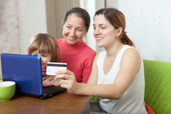 Family of three generations buying online with laptop Royalty Free Stock Images