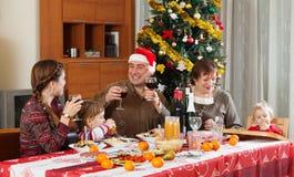 Family of three generations celebrating New Year Stock Photography